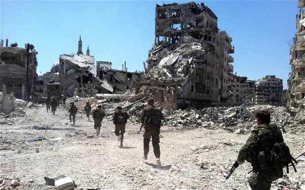 Syrian government forces patrol the Khalidiyah neighbourhood of Homs, mid-2013. Photo: AFP/Getty Images